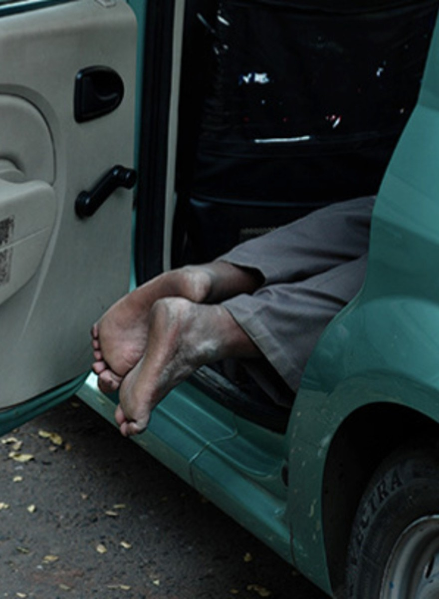 Wait, Are These Taxi Drivers Sleeping or Dead?