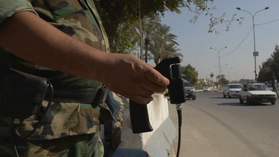 In Saddam's Shadow