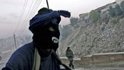 Thomas Dworzak a des clichés de Marines qui pleurent et de talibans qui se marrent