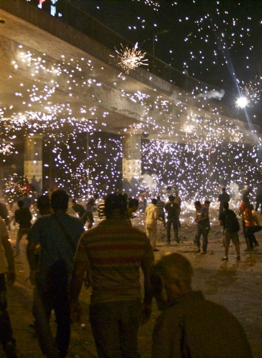 A Divided Egypt Battles with Fireworks, Rocks, and Guns