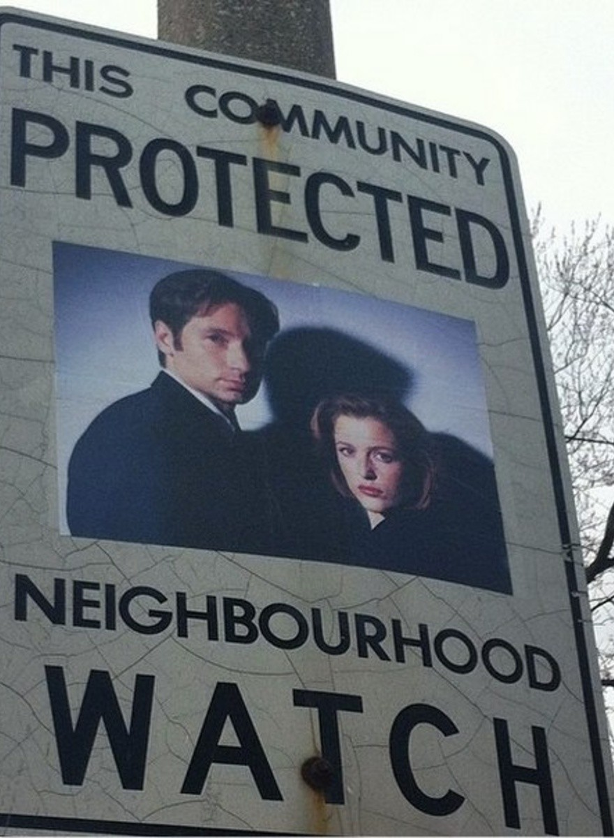 This Artist Adds Superheroes and Crime Fighters to Neighborhood Watch Signs
