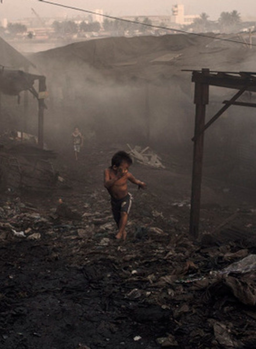Willkommen in Smokey Mountain, einem der größten Kinderarbeitslager der Welt