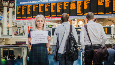 We Tried to Get a Job by Holding Up Signs at a Train Station