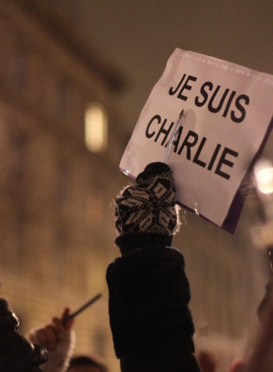 Foto's van de Charlie Hebdo-wake in Parijs