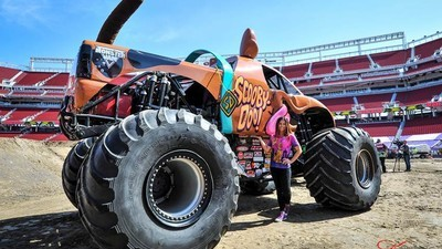 This Badass Female Monster Truck Driver Does Backflips in a Scooby Doo–Shaped Car
