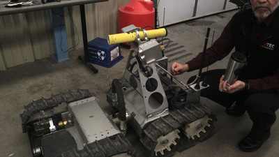 ​A New Weapon for SWAT Teams: Bomb-Squad Robots