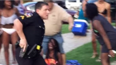 Video Shows Texas Cop Drawing Gun and Pulling Teenage Girl's Hair While Breaking Up Pool Party