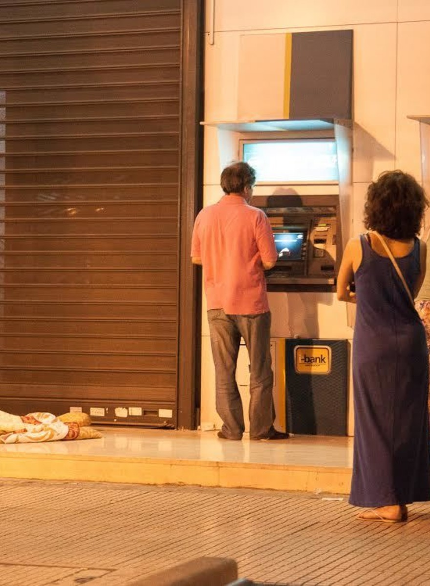 Greeks Are Emptying Their Bank Accounts After Last Night's Referendum Announcement