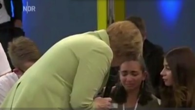 Watch Angela Merkel Tell a Crying Teenage Refugee Why She Has to Leave Germany