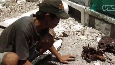 Filipińskie slumsy pośród kości i grobów