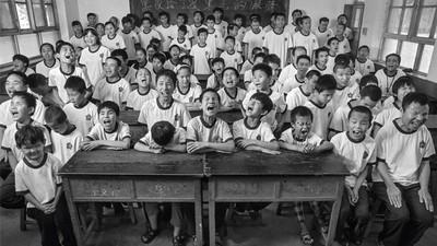 Portretten van blinde kinderen op het Chinese platteland