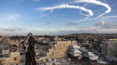 Le chagrin, la fierté, et l'espoir sur les ruines de Kobané