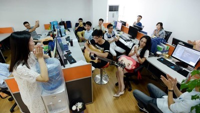Chinese Startups Are Hiring Office Cheerleaders to Boost Productivity