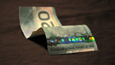 People Are Literally Cutting $20 Bills in Half to Make Two Tens In This Quebec Town