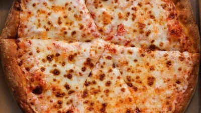 The Way You Eat Pizza Says a Lot About You, According to Body Language Experts