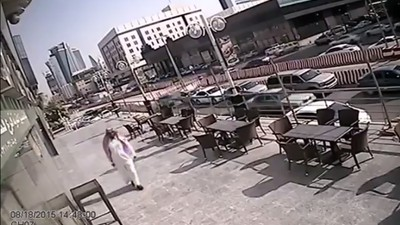Watch a Falling Pane of Glass Narrowly Miss Slicing a Man in Half