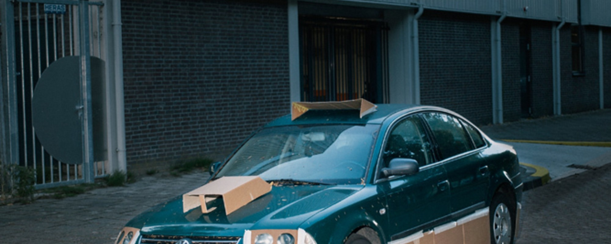 This Guy Walks the Streets at Night Pimping Strangers' Rides with Cardboard