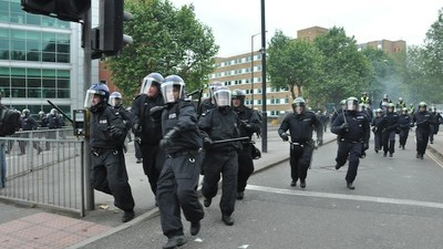Are British Police Tactics Responsible for Clashes at Raves and Rallies?