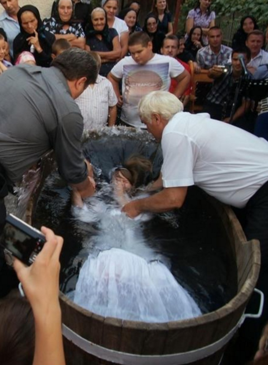 Dramatic Photos of Fully Grown Adults Getting Baptized