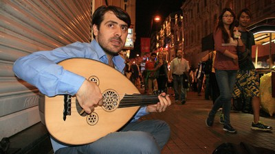 This Syrian Composer Is Now a Refugee Writing Music on the Street