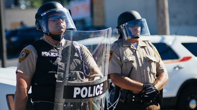 A Veteran Black Cop Talks Police Militarization and the Racial Divisions Still Plaguing Ferguson