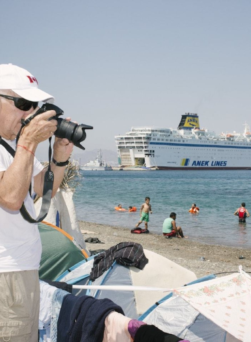 Selfie Sticks and Detention Cages: Photos of Refugees Arriving in Tourist Destinations