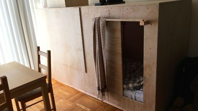 Meet the Guy Paying $400 to Live in a Literal Wooden Box Inside Someone Else's Apartment