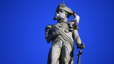 Why Greenpeace Activists Put Gas Masks on London's Famous Monuments