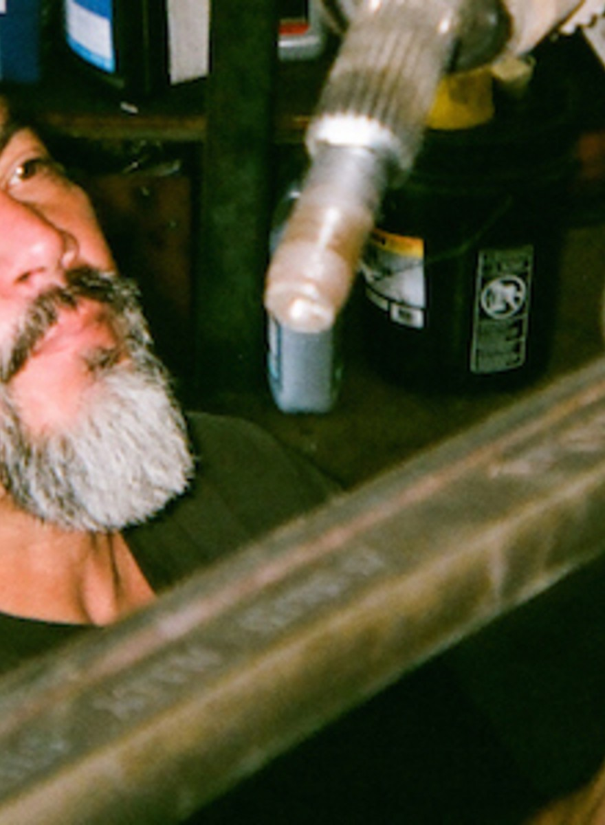 A Car Mechanic Photographs a Weekend of Beers, Grease, and Nudie Calendars