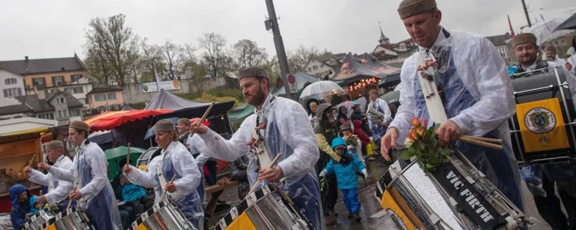 Photos of People Trying to Have a Good Time at a Rainy Spring Parade
