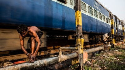 Why India's Homeless Children Are Choosing to Live Along Kolkata's Busy Train Tracks