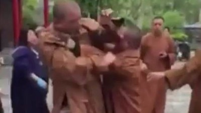 Watch Three Buddhist Monks Brawl in Front of a Temple