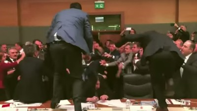 Watch Turkish Parliament Members Kick One Another in the Head During a Brawl