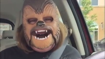 This Video of a Woman in a Chewbacca Mask Brings a Small Shred of Joy to Our Dark World