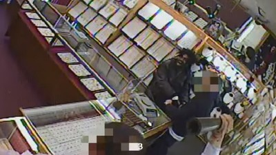 ​Video Shows Jewelers Fight Off Armed Robbers with Acid, Machete, and Metal Chairs