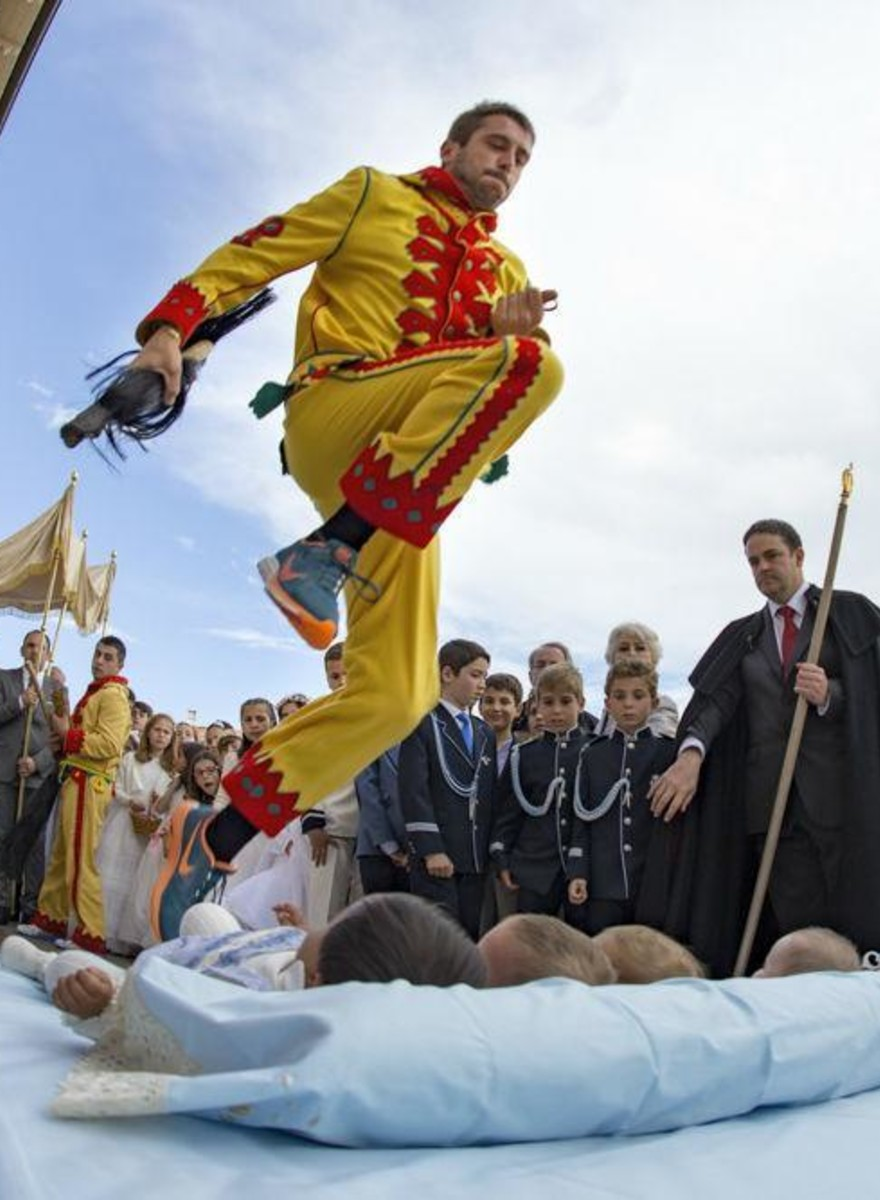 The Strange Tradition Where People Dress Up As Demons and Jump over Babies