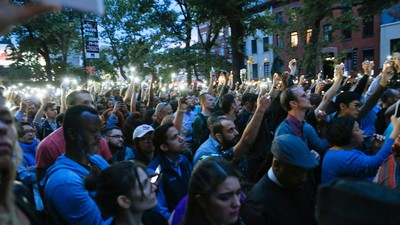 Photos of New Yorkers Paying Respect to Victims of the Orlando Shooting