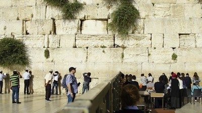 Photos of Men and Women Praying at Separate Parts of the Western Wall