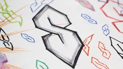 Wat is toch die 'S' die iedereen op school tekende?
