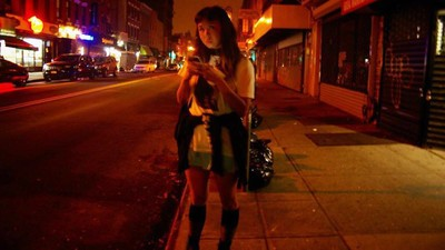 A Girl Walks Home Alone at Night, from the Club