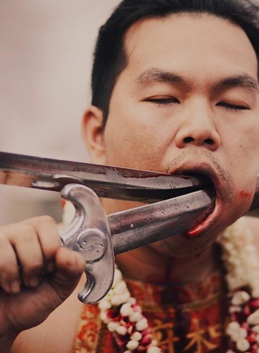 Brutal Photos of Men Impaling Themselves at a Thai Festival
