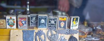 Ein AfD-Spitzenpolitiker handelt in seinem Laden mit KZ-Geld und Nazi-Orden