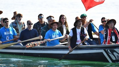 Haidas Wear 'No LNG' Shirts While Paddling Will and Kate in Canoe