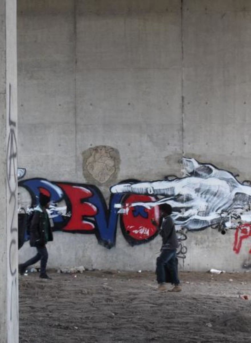 Foto dell'evacuazione della Giungla di Calais