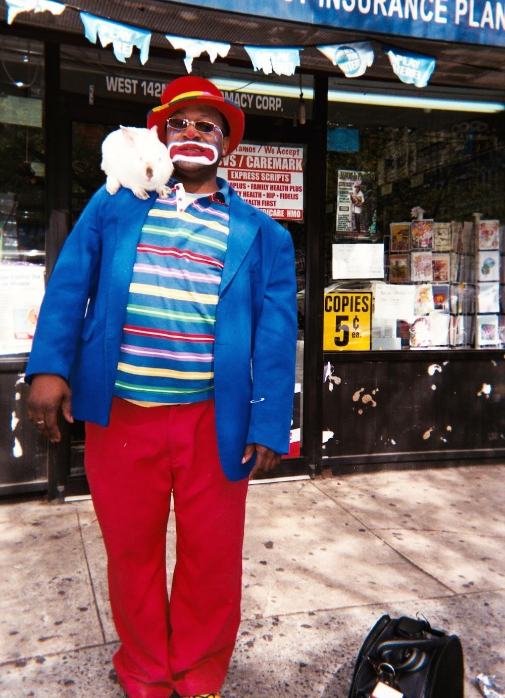 photos of a clown magician pulling tricks and cracking smiles vice