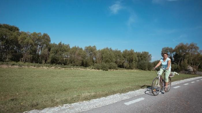 Photos of Romanians Cycling In the Countryside