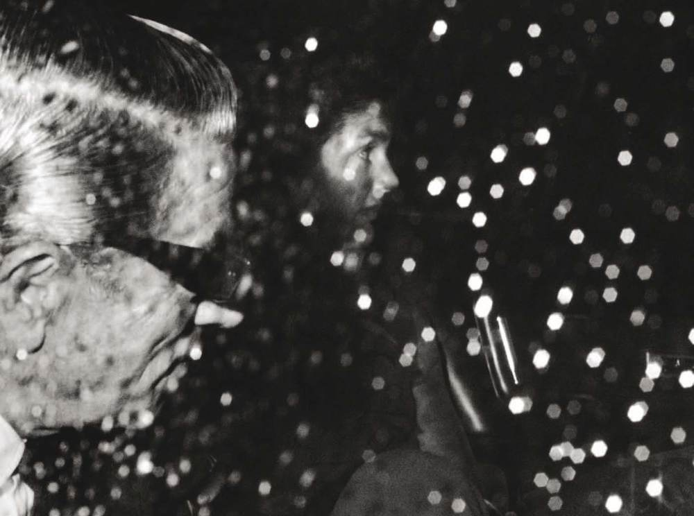 Jackie and Ari Onassis seen through a rainy window on November 14, 1970, at La Côte Basque in New York City.