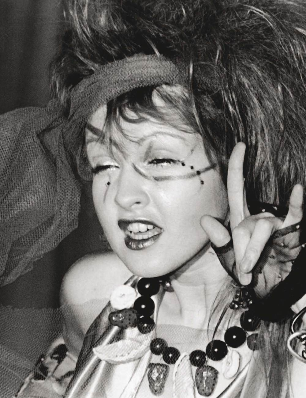 Cyndi Lauper looking suitably new-wave (and suitably soused) at the after-party for the 1984 Grammy Awards at Rex II Restaurant in LA.