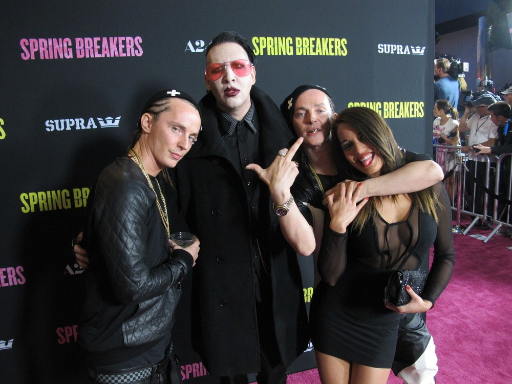 "Here we are on the red carpet with our fine-ass fucking French bombshell and our new weirdo homie Marilyn Manson! We scared all the Selena Gomez fans! We heard them say, ""Manson's so gross and creepy! Also, ewww who are those twins?"" It was amazing!"
