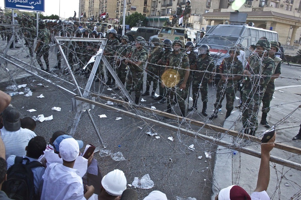 Soldiers face off with supporters of former President Morsi.